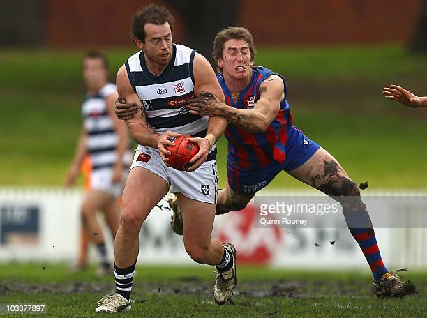 Ben Kennedy of Geelong is tackled by Phillip Raymond of Port Melbourne during the round 17 VFL match between Port Melbourne and Geelong at Teac Oval...