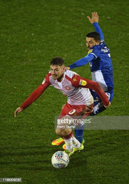Ben Kennedy of Stevenage looks to break past Liam Sercombe of Bristol Rovers during the Leasingcom Trophy Third Round match between Bristol Rovers...
