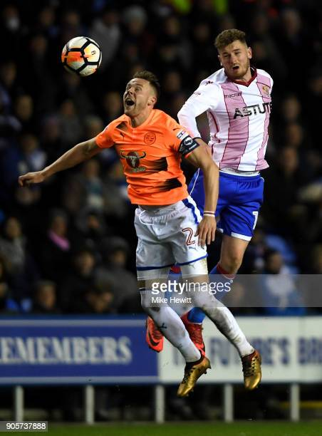 Ben Kennedy of Stevenage outjumps Chris Gunter of Reading during The Emirates FA Cup Third Round Replay match between Reading and Stevenage at...