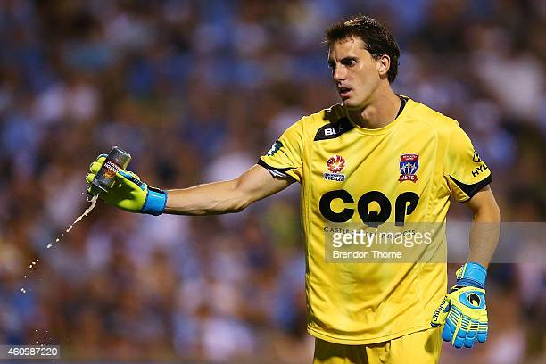 Ben Kennedy of the Jets picks up a can of beer thrown onto the field of play by a Sydney FC fan during the round 15 ALeague match between Sydney FC...