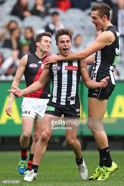 Ben Kennedy of the Magpies celebrates a goal during the round 23 AFL match between the Collingwood Magpies and the Essendon Bombers at Melbourne...