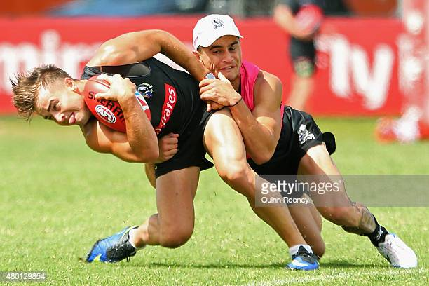 Ben Kennedy of the Magpies is tackled by Marley Williams during a Collingwood AFL preseason training session at Westpac Centre on December 8 2014 in...