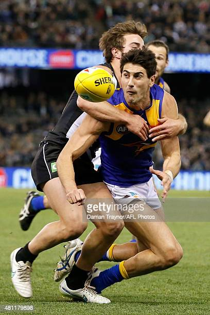Ben Kennedy of the Magpies tackles Matt Rosa of the Eagles during the round 16 AFL match between the Collingwood Magpies and the West Coast Eagles at...