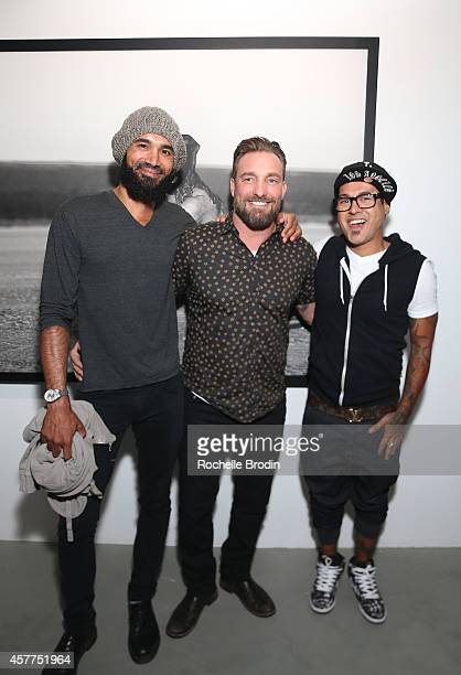 Ben Kenney and Jose Pasillas of the band Incubus and photographer Brian Bowen Smith attend the Brian Bowen Smith WILDLIFE show hosted by Casamigos...