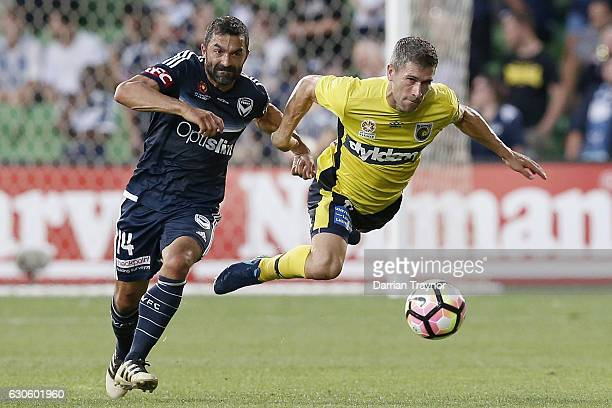 Ben Khalfallah of the Victory challenges Nick Montgomery of Central Coast Mariners during the round 12 ALeague match between Melbourne Victory and...