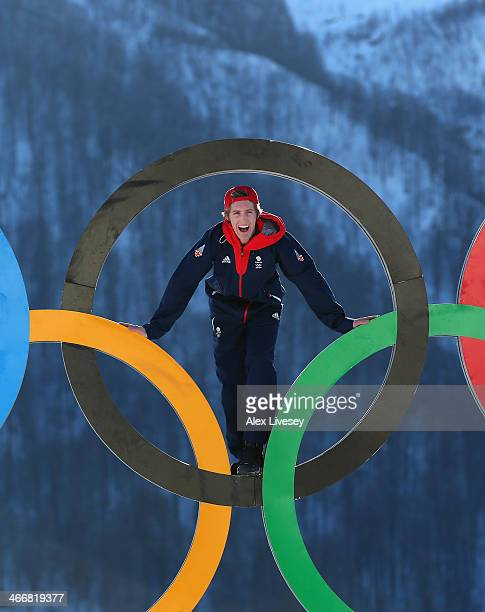 Ben Kilner of the Great Britain Snowboard Team poses for a portrait on the Olympic rings at the Athletes Village in the Rosa Khutor mountain village...