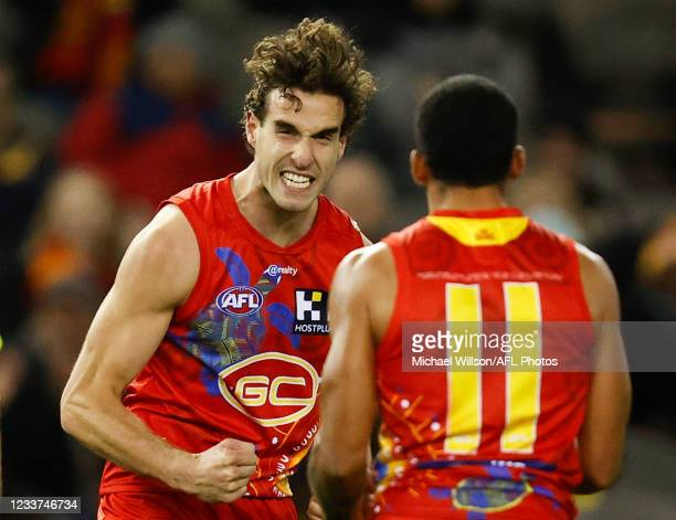 Ben King and Touk Miller of the Suns celebrate during the 2021 AFL Round 16 match between the Gold Coast Suns and the Richmond Tigers at Marvel...