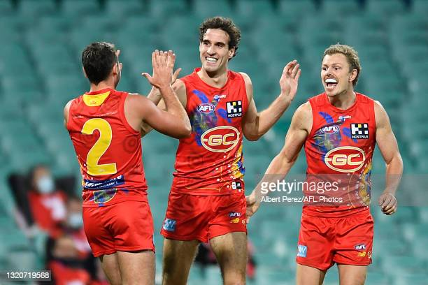 Ben King of the Suns celebrates a goal with team mates during the round 11 AFL match between the Gold Coast Suns and the Hawthorn Hawks at Sydney...