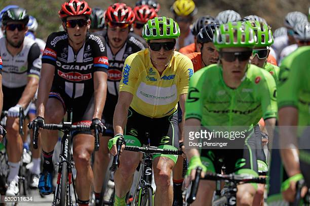 Ben King of the United States riding for Cannondale Pro Cycling in the overall race leader's yellow jersey rides in the peloton during stage three of...