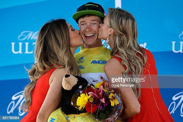 Ben King of the United States riding for Cannondale Pro Cycling takes the podium to receive the overall race leader's yellow jersey after winning...