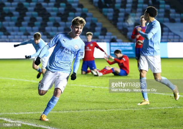 Ben Knight of Manchester City celebrates after scoring his teams first goal to make the score 1-1 during the Premier League 2 match between...