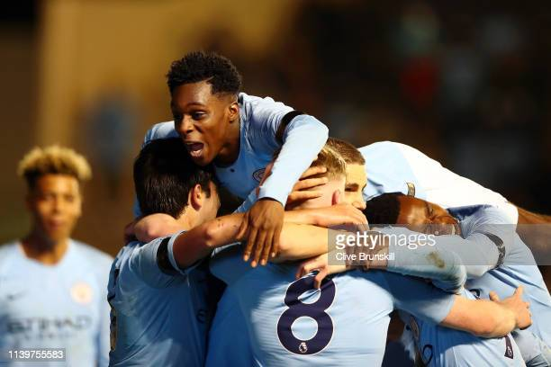 Ben Knight of Manchester City celebrates with his teammates after he scores his sides third goal during the FA Youth Cup match between Manchester...