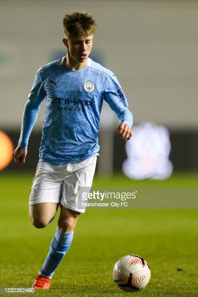 Ben Knight of Manchester City controls the ball during the Premier League 2 match against Manchester United at Manchester City Football Academy on...