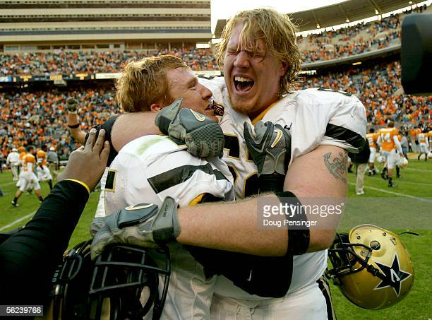 Ben Koger and Ryan King of the Vanderbilt Commodores celebrate after the Commodores defeated the Tennessee Volunteers 2824 on November 19 2005 at...