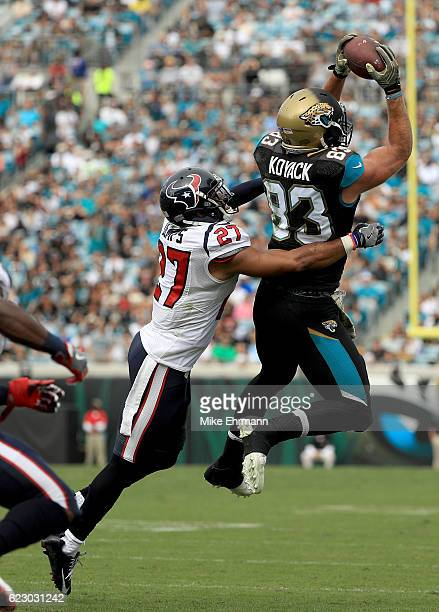 Ben Koyack of the Jacksonville Jaguars catches a pass in front of Quintin Demps of the Houston Texans during the game at EverBank Field on November...