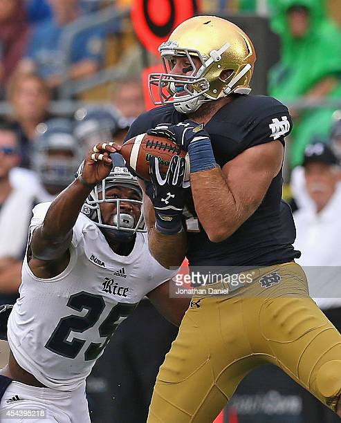 Ben Koyack of the Notre Dame Fighting Irish catches a first down ball over Jaylon Finner of the Rice Owls at Notre Dame Stadium on August 30, 2014 in...