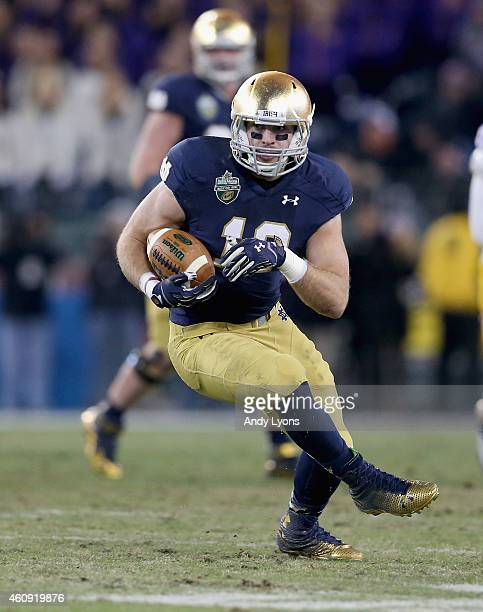 Ben Koyak of the Notre Dame Fighting Irish runs with the ball on the game winning drive in the fourth quarter against the LSU Tigers in the Franklin...