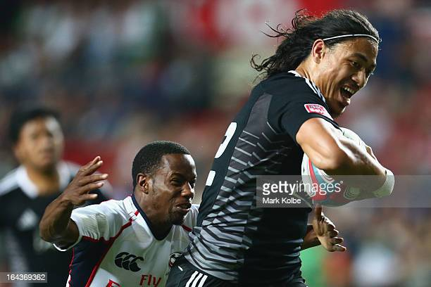 Ben Lam of New Zealand breaks away to score a try during the match between New Zealand and the USA on day two of the 2013 Hong Kong Sevens at Hong...