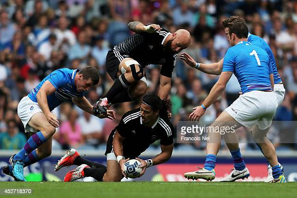 Ben Lam of New Zealand is hurdled by teammate DJ Forbes in the Rugby Sevens match between New Zealand and Scotland at Ibrox Stadium during day three...