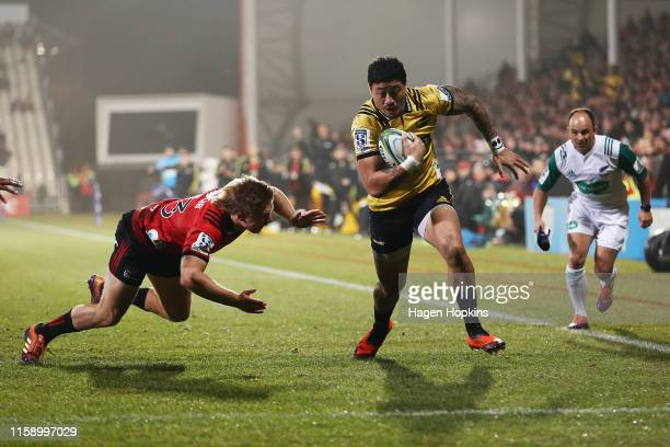 Ben Lam of the Hurricanes attempts to evade Jack Goodhue of the Crusaders during the Super Rugby Semi Final between the Crusaders and the Hurricanes...