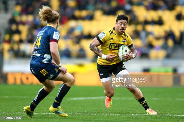 Ben Lam of the Hurricanes attempts to evade Scott Gregory of the Highlanders during the round 5 Super Rugby Aotearoa match between the Hurricanes and...