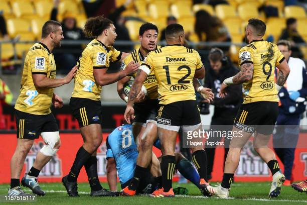 Ben Lam of the Hurricanes celebrates with Dane Coles Peter UmagaJensen Ngani Laumape and TJ Perenara after scoring a try during the Super Rugby...