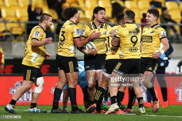 Ben Lam of the Hurricanes celebrates with teammates after scoring a try during the Super Rugby Quarter Final match between the Hurricanes and the...