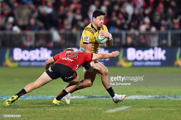 Ben Lam of the Hurricanes charges forward during the Super Rugby Semi Final match between the Crusaders and the Hurricanes at AMI Stadium on July 28...