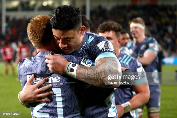 Ben Lam of the Hurricanes congratulates Jamie Booth of the Hurricanes after winning the round 7 Super Rugby Aotearoa match between the Crusaders and...