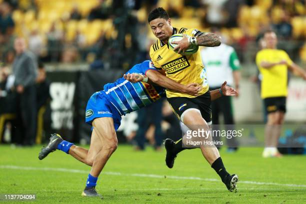 Ben Lam of the Hurricanes is tackled by Dillyn Leyds of the Stormers during the round six Super Rugby match between the Hurricanes and the Stormers...