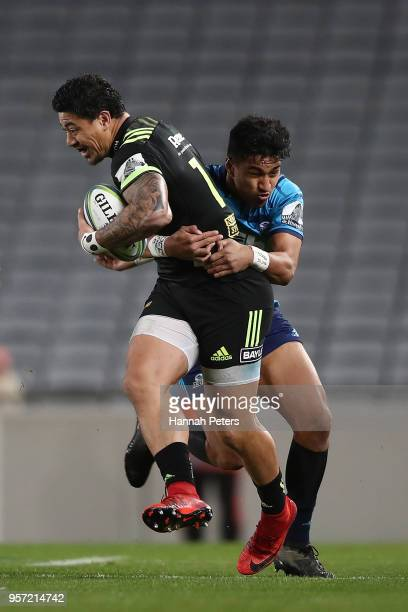 Ben Lam of the Hurricanes is tackled by Rieko Ioane of the Blues during the round 12 Super Rugby match between the Blues and the Hurricanes at Eden...