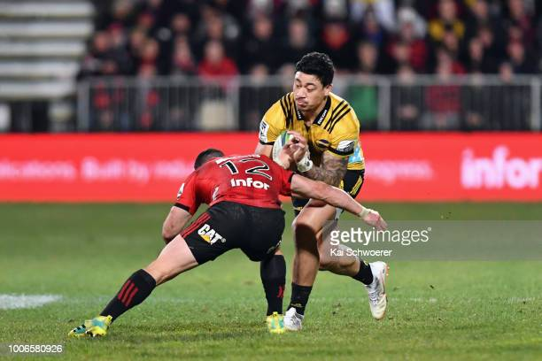 Ben Lam of the Hurricanes is tackled by Ryan Crotty of the Crusaders during the Super Rugby Semi Final match between the Crusaders and the Hurricanes...