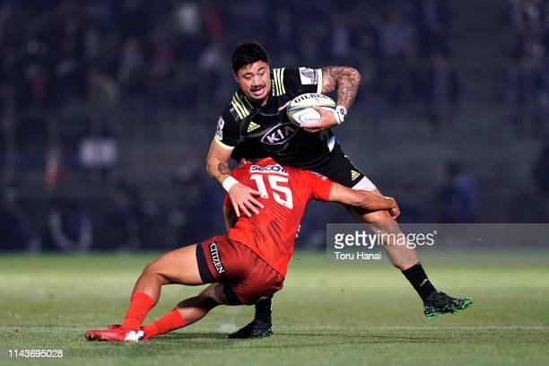 Ben Lam of the Hurricanes is tackled by Ryohei Yamanaka of the Sunwolves during the Super Rugby match between Sunwolves and Hurricanes at the Prince...