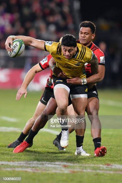 Ben Lam of the Hurricanes is tackled by Seta Tamanivalu of the Crusaders during the Super Rugby Semi Final match between the Crusaders and the...