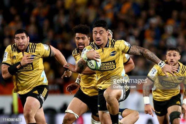 Ben Lam of the Hurricanes makes a break during the round 8 Super Rugby match between the Highlanders and Hurricanes at Forsyth Barr Stadium on April...