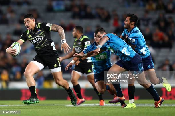 Ben Lam of the Hurricanes makes a break to score a try during the round 13 Super Rugby match between the Blues and the Hurricanes at Eden Park on May...