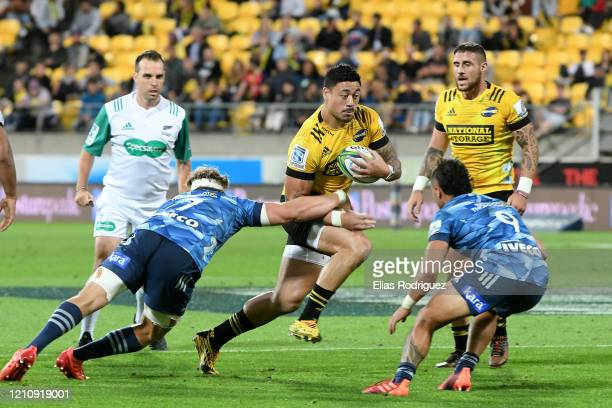 Ben Lam of the Hurricanes makes a run during the round six Super Rugby match between the Hurricanes and the Blues at Westpac Stadium on March 07,...