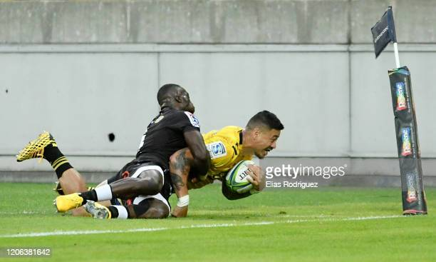 Ben Lam of the Hurricanes scores a try during the round 3 Super Rugby match between the Hurricanes and the Sharks at Westpac Stadium on February 15...