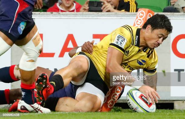 Ben Lam of the Hurricanes scores a try during the round seven Super Rugby match between the Rebels and the Hurricanes at AAMI Park on March 30 2018...
