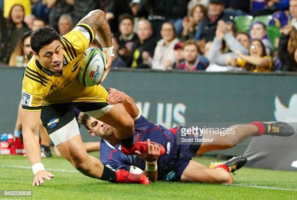 Ben Lam of the Hurricanes scores his fourth try during the round seven Super Rugby match between the Rebels and the Hurricanes at AAMI Park on March...