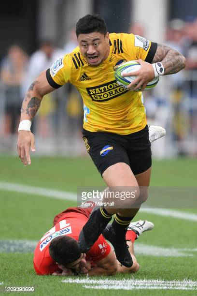 Ben Lam of the Hurricanes slips a tackle during the round five Super Rugby match between the Hurricanes and the Sunwolves at McLean Park on February...