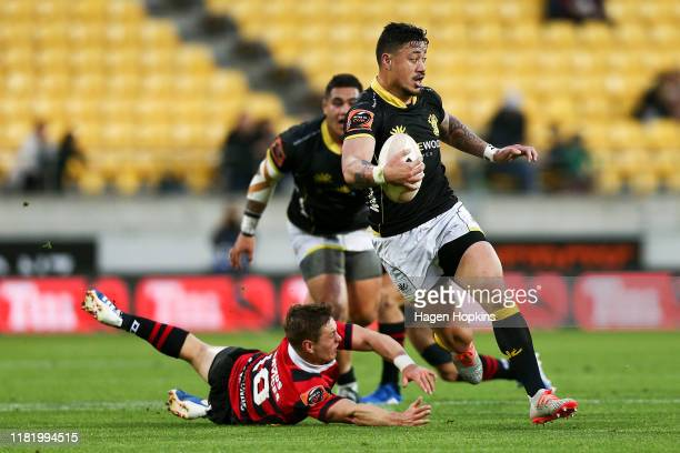 Ben Lam of Wellington evades the tackle of Brett Cameron of Canterbury during the Mitre 10 Cup Premiership semi final match between Wellington and...