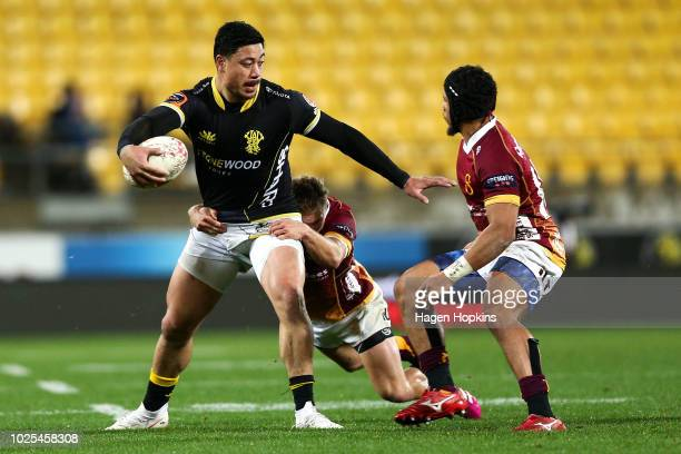 Ben Lam of Wellington is tackled by Broc Hooper and Isaac Te Tamaki of Southland during the round three Mitre 10 Cup match between Wellington and...