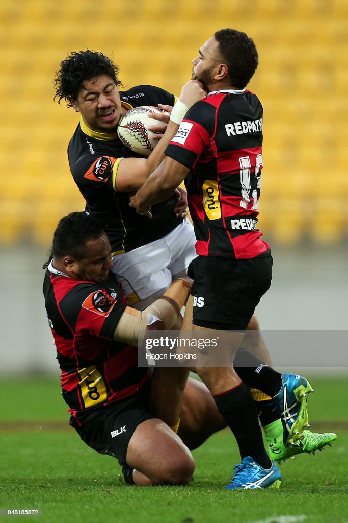 Ben Lam of Wellington is tackled by Inga Finau and Siate Tokolahi of Canterbury during the round five Mitre 10 Cup match between Wellington and Canterbury at Westpac Stadium on September 17, 2017 in Wellington, New Zealand.