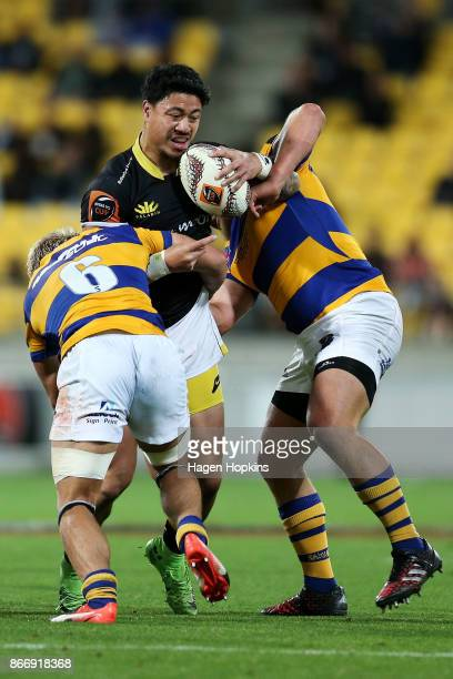 Ben Lam of Wellington is tackled by Mitchell Karpik of Bay of Plenty during the Mitre 10 Cup Championship Final match between Wellington and Bay of...