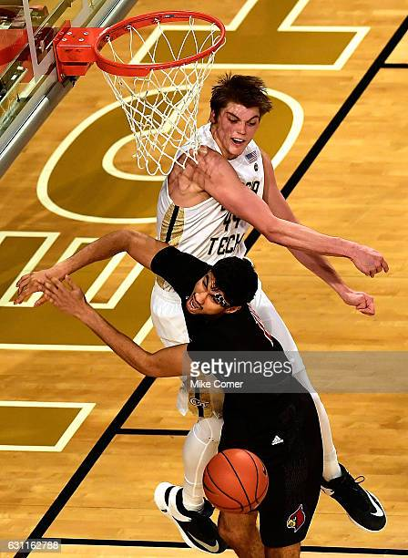 Ben Lammers of the Georgia Tech Yellow Jackets commits a hard foul against Anas Mahmoud of the Louisville Cardinals during the game at Hank McCamish...