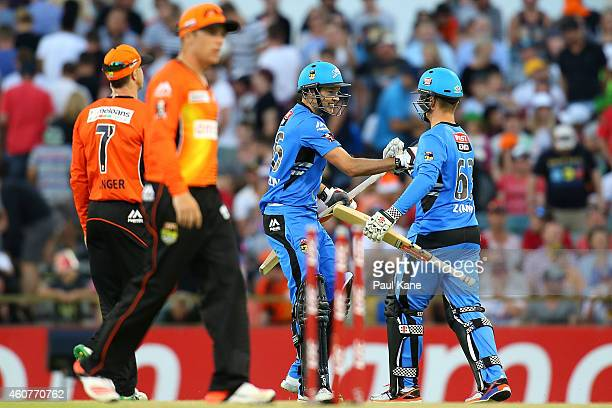 Ben Laughlin and Adam Zampa of the Strikers celebrate winning the Big Bash League match between the Perth Scorchers and Adelaide Strikers at WACA on...