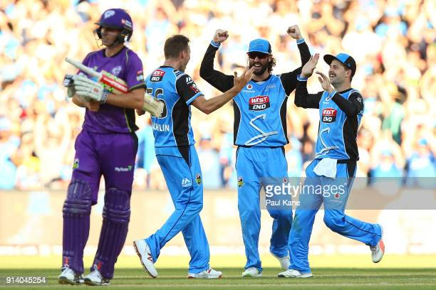 Ben Laughlin Jono Dean and Liam O'Connor of the Strikers celebrate winning the Big Bash League Final match between the Adelaide Strikers and the...