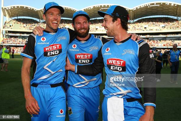 Ben Laughlin Michael Neser and Travis Head of the Strikers celebrate after winning the Big Bash League Final match between the Adelaide Strikers and...