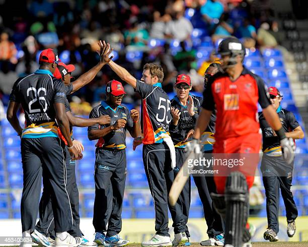 Ben Laughlin of Antigua Hawksbills celebrates the dismissal of Ross Taylor of The Trinidad and Tobago Red Steel during a match between Antigua...